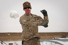 U.S. Air Force Capt. Tyler Johnson, from San Antonio, Texas, who is a lead engineer for the Paktya Provincial Reconstruction Team, Task Force Spartan, flings a snowball during an epic snowball fight with paratroopers of the 3rd Battalion, 509th Infantry Regiment on Forward Operating Base Gardez, Feb. 20.  Read more: http://www.dvidshub.net/image/529417/tf-gold-geronimo-soldiers-paktya-prt-wage-epic-snow-fight-gardez#ixzz1psJk9KGD