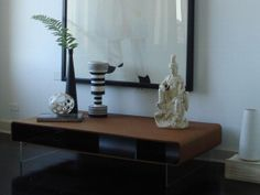 LIVING ROOM HOLDS MIXED MEDIA ART-table is awesome