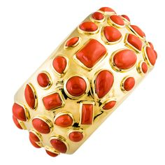 "Chic and unusual yellow gold and coral cuff bracelet, from the ""50's"" collection by Seaman Schepps."
