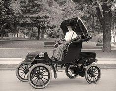 Woman driving car, 1905