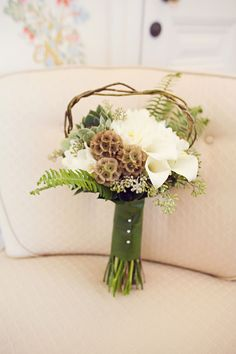 Pretty woodlands style bouquet featuring calla lilies, scabiosa, succulents, eucalyptus, curly willow or vine, and fern. Perfect for a rustic or woodlands wedding. wedding flower boutonniere, groom boutonniere, groom flowers, add pic source on comment and we will update it. www.myfloweraffair.com can create this beautiful wedding flower look.
