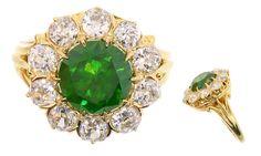 Demantoid garnet , diamond and 18 karat yellow gold ring, with 1 round demantoid garnet weighing 3.23 carats and 10 old European cut diamonds weighing 2.00 carats. Circa 1950's.
