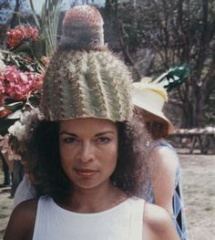Bianca Jagger wearing a cactus on her head.