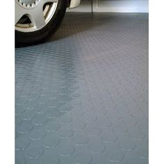 Another flooring possibility: Coin Grip Rubber flooring...as seen in restaurant kitchens, garages...