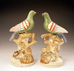 Pair of Staffordshire pottery figures of exotic birds Victorian mid 19thc