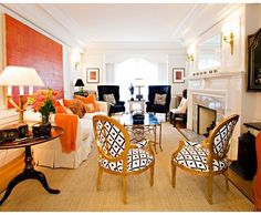 The Impact of Art - Design Chic - Abstract Art over the living room sofa is gorgeous!!