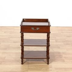 This telephone stand is featured in a solid wood with a mahogany stain. This traditional style side table has a single spacious drawer, 3 tiers, and carved turning legs. Can also double as a nightstand! #americantraditional #tables #endtable #sandiegovintage #vintagefurniture