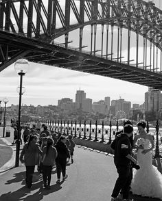 A bride can be mesmerising. The bridge meh.  #wedding #weddingday #weddingdress #photoshoot #photoart #photo #sydneyharbourbridge #blackandwhite #sydney #bride #bridal #love #princess #photographer #canon #marriage #bridge #thepeoplewemet #engagepeople #life #photographer #sydneyphotographer #sydneystreets by marisastor http://ift.tt/1NRMbNv