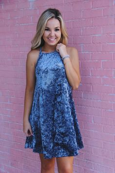We are loving that the crushed velvet trend is still going. Everyone needs a staple dress like this in their closet! The dress is a dusty blue color in a gorgeous crushed velvet. Dress runs true to si