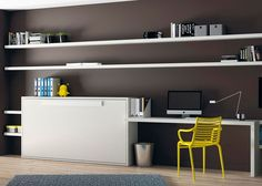 #Dormitorio juvenil con #cama #abatible horizontal y mesa estudio con estanterias a pared soporte oculto.