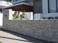 Eco Outdoor Newport random ashlar stone limestone walling fence, install by Natural Elements. | Eco Outdoor | Newport random ashlar walling | livelifeoutdoors | Outdoor Design | Natural stone walling | Garden design | Outdoor paving | Outdoor design inspiration | Outdoor style | Outdoor ideas | Luxury homes | Paving ideas | Garden ideas | Stone veneer | Stone walling | Stone wall cladding | Stone feature wall | retaining wall