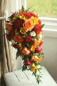 Autumn teardrop bouquet with roses, freesia, eustoma, dianthus, astilbe and eucalyptus. Liberty Blooms Wedding Flowers East Lothian, Scotland.