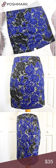 """Banana Republic Skirt Adorable skirt made by Banana Republic.  Features and all over rose pattern in colors of royal blue, gray, and black. Material is made of 100% polyester. Skirt is in pristine condition. Skirt has a 4 1/2"""" slit in the back and zips on the side with hook eye closure.  Elasticized in the back waistband. Measurements laying flat: waist 15 inches, hip 19 inches, and length 18 inches. Banana Republic Skirts"""