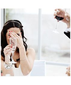 Friends and Family Making Toasts | 27 Must-Take Wedding Photo Ideas - Real Simple