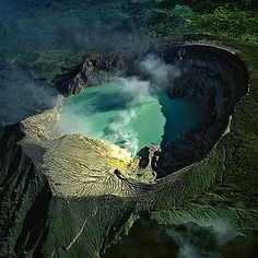 Bernhard Edmaier  KAWAH IJEN  This volcano in the eastern part of Java, Indonesia, contains an acid lake in its crater. Sulphur vapours seep out of its walls and form big crusts, which the locals painstakingly remove and transport to the valley.