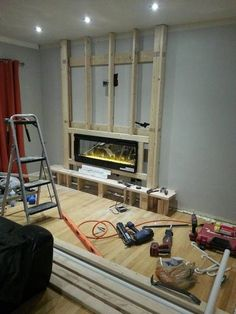 We could install an electric fireplace into the space of our old fireplace.