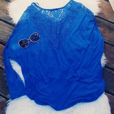"""Dolman shirt with lace back detail Dolman shirt with lace detail in the back  3/4 sleeve """"bat wing"""" sleeve style Medium in blue Small in black 20% off all bundles of 2+ Tops Blouses"""
