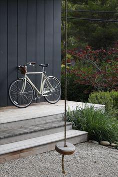 Backyard simplicity - garden gravel, wood deck steps, and simple swing