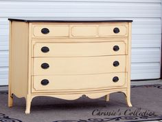 """Mahogany bow front dresser painted in General Finishes Buttermilk Yellow with antique glazing. Java stained top. Measures 48""""x21.5"""" and 36""""t. $425, available to be seen in the warehouse."""
