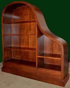 Baby grand piano case re-purposed as a shelving or entertainment center.