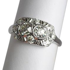 Two are better than one! This stunning Art Deco diamond ring features a matched pair of European cut diamonds - together weighing 1.0 carat. This