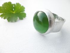 Natural jade ring made in sterling silver.
