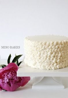 White buttercream cake decorated with #18 tip.