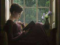 Reading in a window seat during the rain