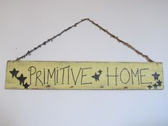 Definitely a primitive sign made on a very old piece of wood. Pound in some nails add a few pip berrys for cuteness...LOVE IT.