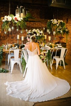 BREWERY WEDDING INSPIRATION | We love this fun and luxurious reception decor! What do you love most? The modern white chairs, the glamorous white, red and green floral arrangements, or the stunning bride and her romantic wedding dress? We still can't decide. Be sure to click to see more from this glamorous day at Mission Brewery. #sandiegowedding #luxurywedding | Always Flawless Productions | A San Diego Wedding Planning & Design Studio