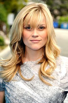 Reese Withersppon with curls and bangs