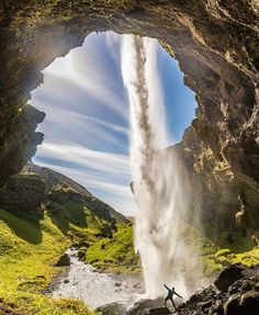 Kvernufoss - a beautiful 98-ft hidden waterfall where you can walk and explore behind the falling waters. Located in a gorge near the Ring Road in southern Iceland and near the much more visited and famous Skogafoss.