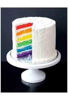 Brides.com: . Slicing into this cake tier reveals a colorful surprise: Each layer is vibrant shade of ROY G. BIV.  Cake by Love & Olive Oil