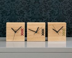 A unique embroidered clock. A beautiful piece for your home or office. Nice on a desk or shelf. Great gift for fathers day.  Solid oak desk clock with leather embroidery.