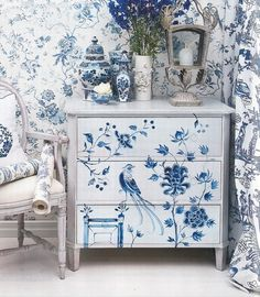 Blue and White stenciled dresser. With the pattern on the wall it's too busy, but the dresser is beautiful!