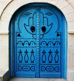 Doors and entrances say a lot about the building/space/occupants. (Hand of Fatima)