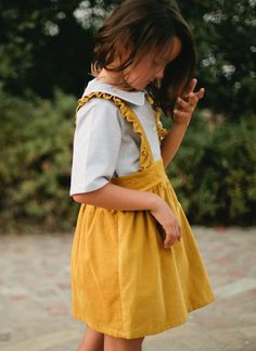 PDF Sewing Patterns, This adorable skirt pattern includes ruffled suspenders and is perfect for beginners looking to increase their sewing skills. Back closes with 1 button and straps are attached with buttons as well. Pair with her favorite boots and collared shirt. Cutting chart is included for all pattern pieces (each pattern pieces is a rectangle).