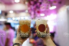 Bubble Milk Tea - Hand holding plastic glass of fresh milk with black sugar syrup and black pearl (Boba) on blurred background. Hand Holding, Holding Hands, Tea Restaurant, Bubble Milk Tea, Plastic Glass, Fresh Milk, Blurred Background, Pint Glass, Syrup
