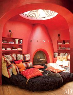 Misty the cat lounges beneath the circular skylight in Jada Pinkett Smith's meditation room.