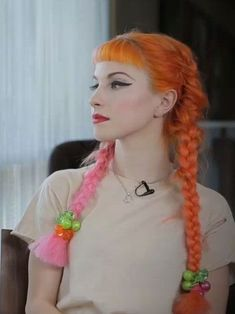 Hayley Williams had extensions put in her hair to make long orange and pink pigtail braids from Paramore's photoshoot with Ladygunn magazine Hayley Paramore, Paramore Hayley Williams, Hayley Williams Style, Hayley Williams Haircut, Hayley Wiliams, Pigtail Braids, Bang Braids, Little Doll, Dream Hair