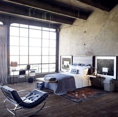 This Zara Home Loft Space Offers Stripped Down Appeal. Raw Cement Walls And  Exposed Wood Ceiling Beams Are Balanced With Textured Bedding, A Cosy Rug,  ...