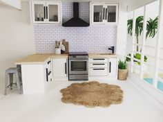 Miniature dollhouse kitchen 1:12 scale, modern dollhouse ideas, Malibu Dollhouse Kit, follow @OneBrownBear on Instagram