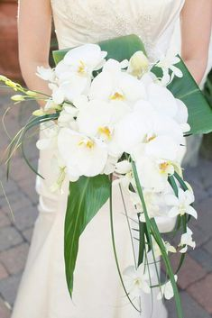 Elegant Cascading Bridal Bouquet Showcasing: White Phalaenopsis Orchids, White Dendrobium Orchids, Green Lily Grass, Green Bear Grass & Green Tropical Foliage~~