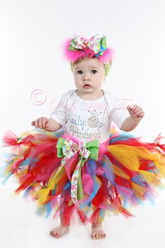 """Lollipop Princess Boutique Little Girls Tutu Twirl Outfit     She'll be the hit of the party in this colorful tutu set! Made with a bright embellished shirt featuring """"Lollipop Princess"""" and bright Lollipop design.     Tutu skirt is our unique petutti style with bright colors. Front of skirt is adorned with a sweet lollipop bow. The perfect finishing touch to any party, photo op and more!"""