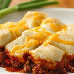 Sloppy Joe Casserole! Winner in my house! I used crescent rolls instead. I placed 1 can on the bottom, placed the sloppy joe mixture (2lbs worth) then rolled a second can of crescent rolls on top. Baked for 15 min. Added some shredded cheese and baked until melted. :)