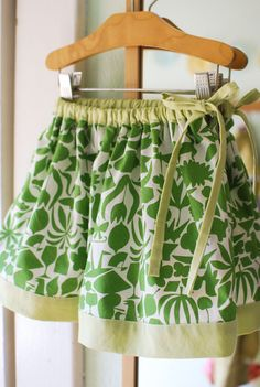 I can't say we were in need of a skirt over here, but thanks to Trinh I was inspired to further expand Lila's skirt wardrobe. This is a modified version of the twirly skirt from House o… Sewing Kids Clothes, Sewing For Kids, Baby Sewing, Diy Clothes, Girls Skirt Patterns, Skirt Patterns Sewing, Toddler Skirt, Baby Skirt, Little Girl Skirts