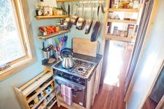 Decoration, Powerful Stove With Good Appliances Frying Pan And Pan Spoon But It's Small Kitchen Competed With Window: Interior Design Of Tiny Houses On Wheels For Sale