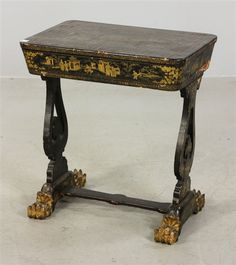 "Partially appointed Chinese sewing table, 19th century, with lion's paw feet, decorated with gilt figures, pagodas and other assorted accents, 28"" h x 25"" w x 17"" d."