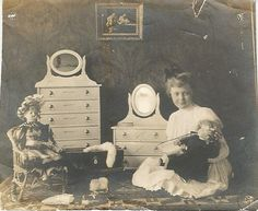 girl in nursery wih two dolls and dresser by Lauren Jaeger Mikalov, via Flickr