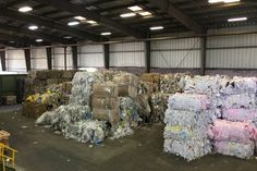 Bales of scrap for recycling in Allan Co. warehouse.